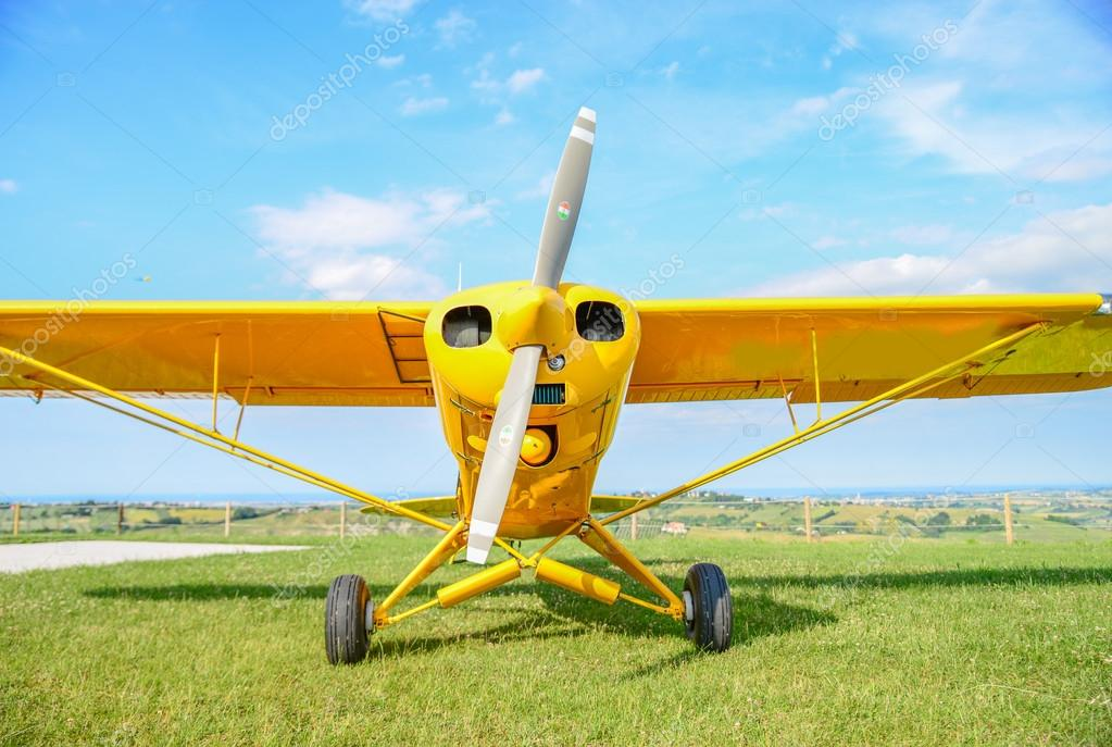 Yellow propeller airplane
