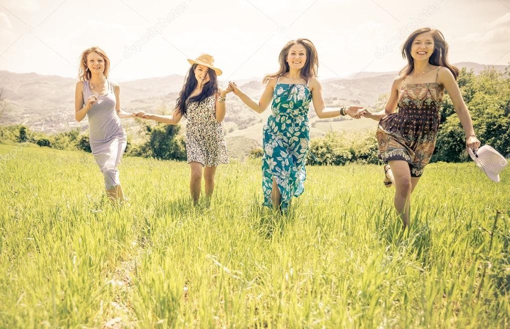 Group of girls running in a field