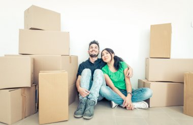 Young couple moving into new apartment