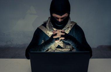 Terrorist working on his computer