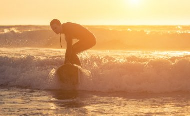 Surfer performing tricks on the waves