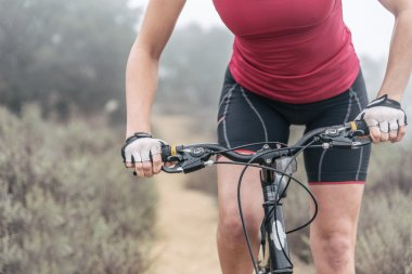 Woman making downhill with mountain bike. Concept about people a
