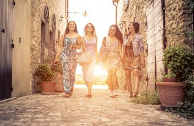 Group of girls walking in a historic center in italy