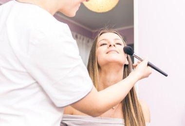 Woman making beauty treatment in a saloon