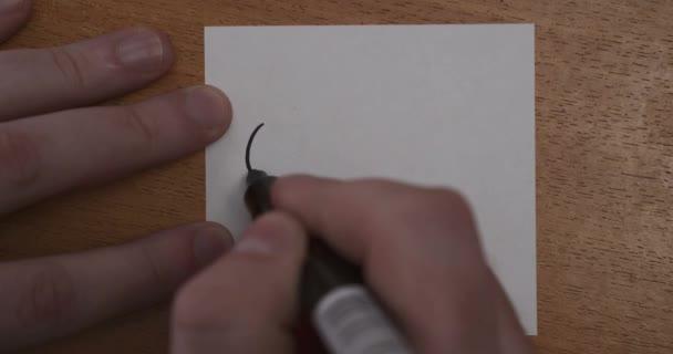 Kézi csuklórajz fekete ceruzával. 4k felvétel
