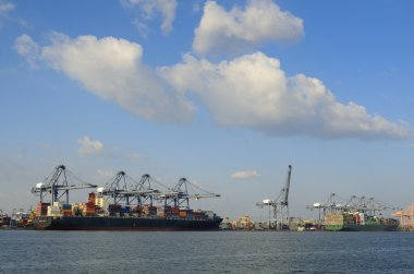 Cargo ship with shipping containers stacked up on deck