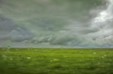 abstract defocused summer rainy lanscape with stormy sky and fie