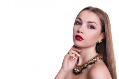 Closeup portrait of a beautiful girl with a black and gold necklace around her neck. Isolated over white background. Copy space.