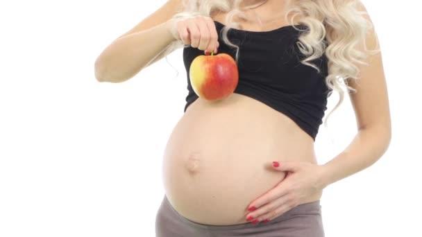 Těhotná žena s zelíčko na její břicho, bílý, detail