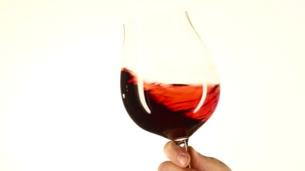 Moving wine glass, white, closeup