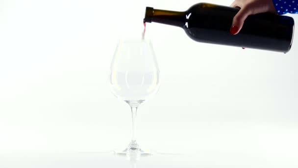 Person pour red wine into a glass, white