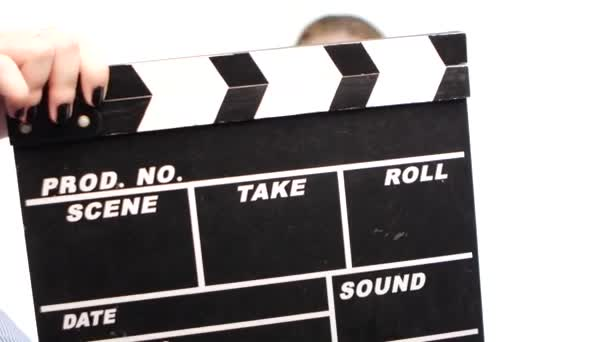Young woman starts leading news, before it is clapper board