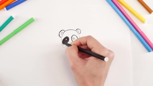 Woman drawing the panda using black felt-tip pen on white paper, time lapse
