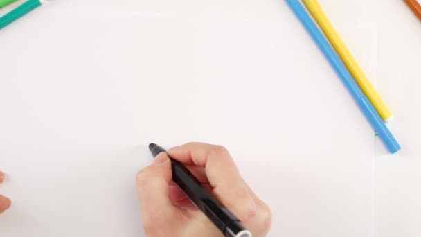 Woman drawing the ellipsis using black felt-tip pen on white paper, time lapse