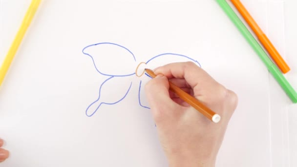 Woman drawing the butterfly using different felt-tip pen on white paper, time lapse
