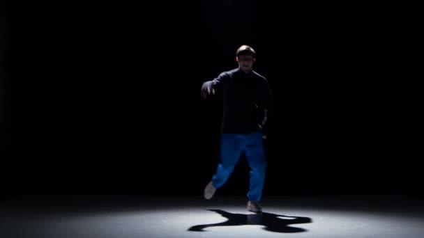 Young dancer man dancing breakdance on hands, black