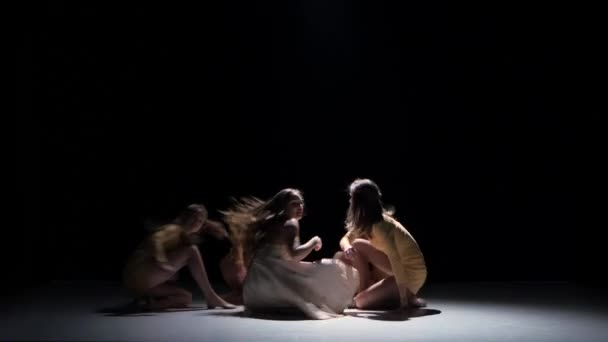 Five beautiful girls dancing modern contemporary dance, on black, shadow