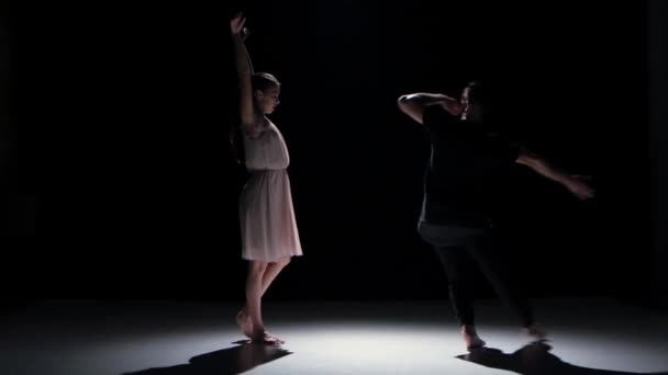 Man and woman performing contemporary dance