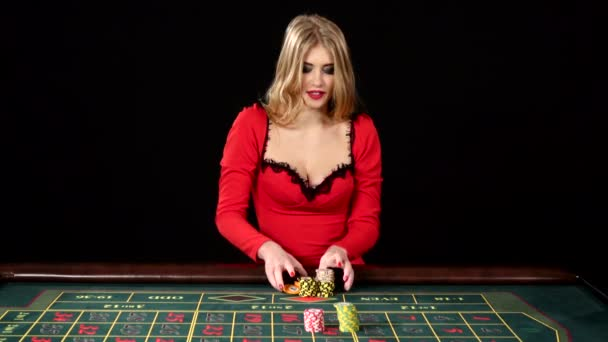 The girl in the red dress lost in the casino. Black