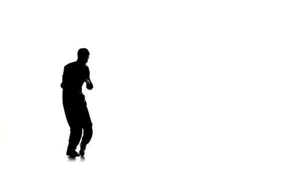 Dancer man dancing breakdance on white, silhouette, slow motion