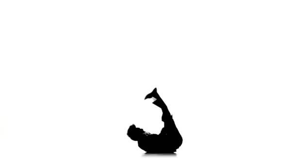 19e710e72 Young dancer man dancing breakdance on white, silhouette, slow motion