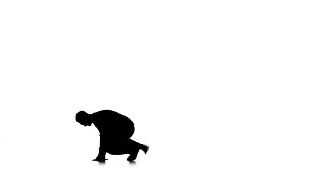Mann tanzt Breakdance professionell bewegt und dreht sich, weiß, Silhouette, Zeitlupe