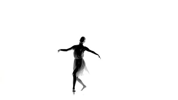 Slim woman with ponytail dance modern contemporary style makes split on white, silhouette, slow motion