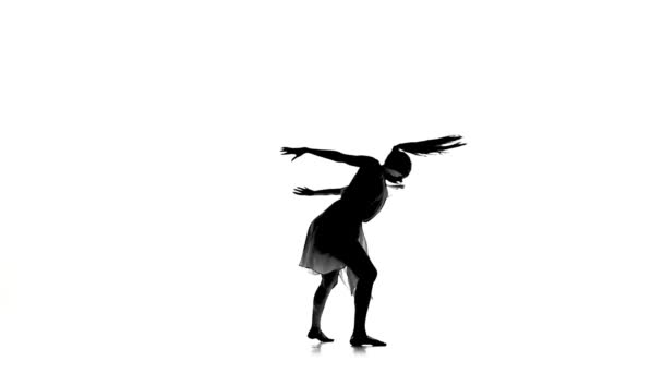 Graceful woman with ponytail dance modern contemporary style on white, silhouette, slow motion