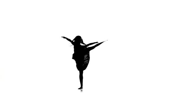 Slim girl with long hair dance modern contemporary style makes split on white, silhouette, slow motion