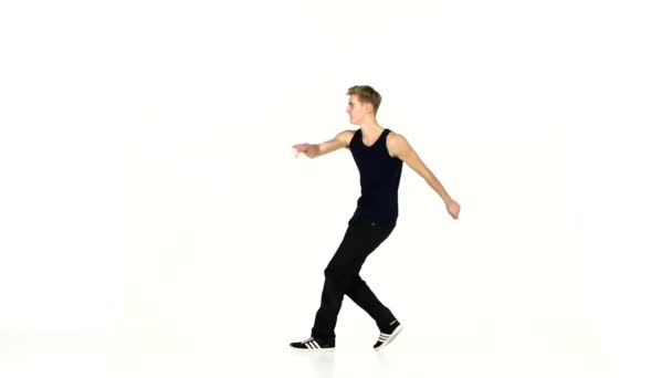 Modern style dancer in black suit continue dancing breakdance on white, slow motion