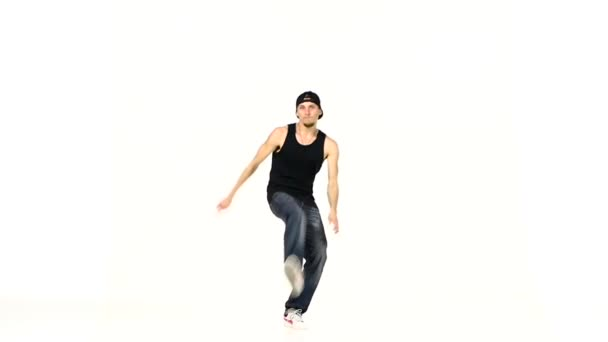Modern style dancer in black suit dancing breakdance on white, slow motion