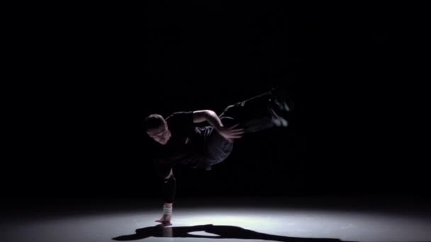 Cool breakdance style dancer dance, on black, shadow, slow motion