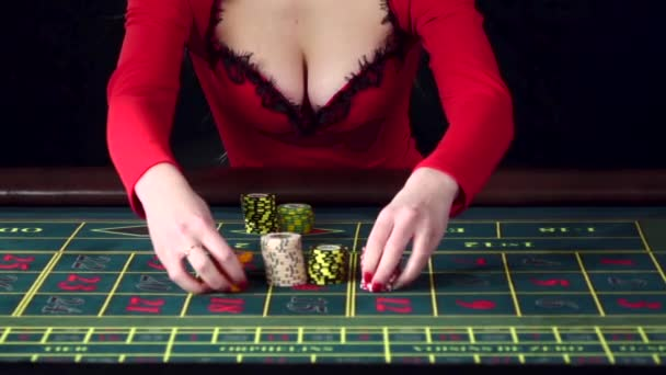 Woman placing an all in bet in roulette. Black