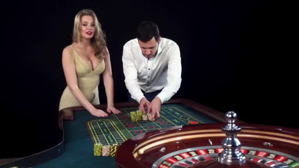 Couple betting on the roulette. Black