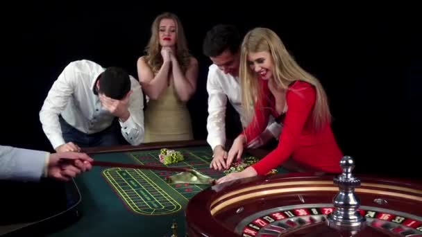 Couple celebrating win at roulette table. Black