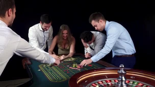 Company playing in casino. Black