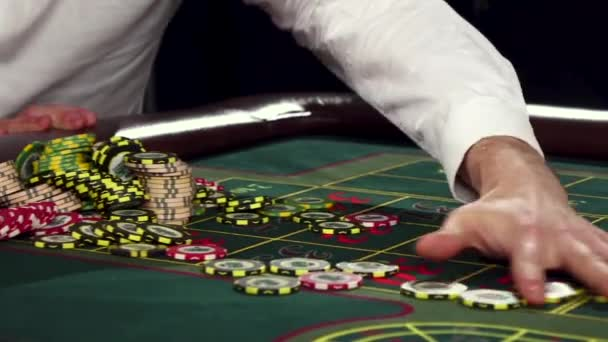 Poker players with chips at green casino table. Black