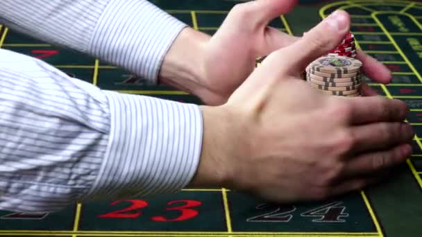 Croupier takes all the chips at casino on roulette table