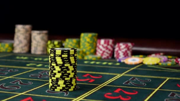 Dark-yellow chips on a gaming table with winning chip, black
