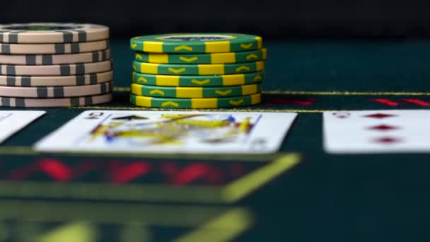 Player bets his chips playing poker, close up, front view