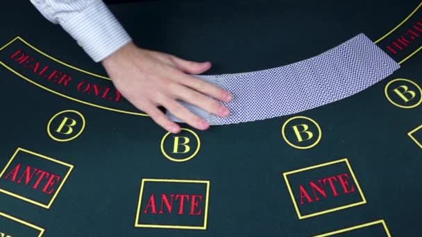 Croupier dealing cards in a poker game table, slow motion