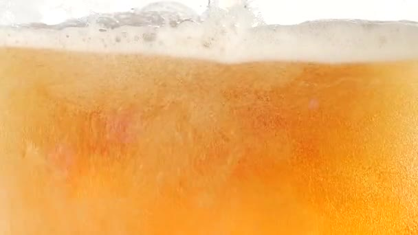 The bubbles floating up in the liquid of beer. Closeup. Slow motion