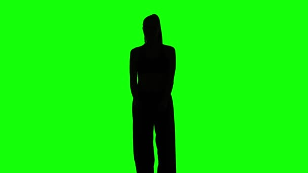 Young girl shows different elements karate. Green. Silhouette