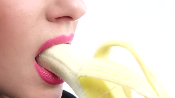 Funny young woman eating banana. Closeup