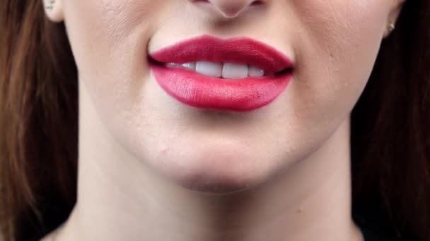 Woman smile with great teeth and red lips. Closeup