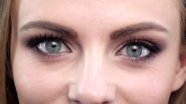 Womans eye, squint. Close up. Slow motion