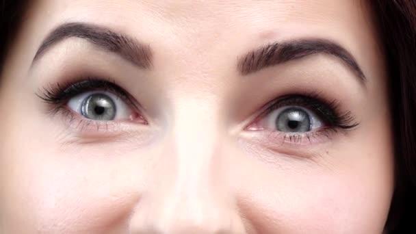 Amazed female on white background. Close up. Slow motion