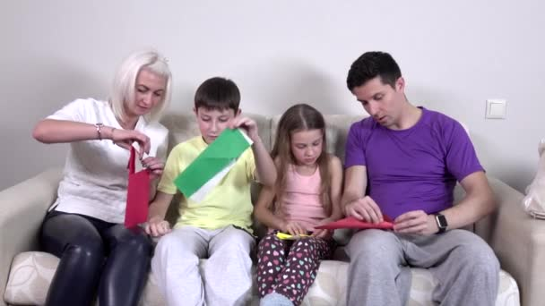 Group kids make origami airplane