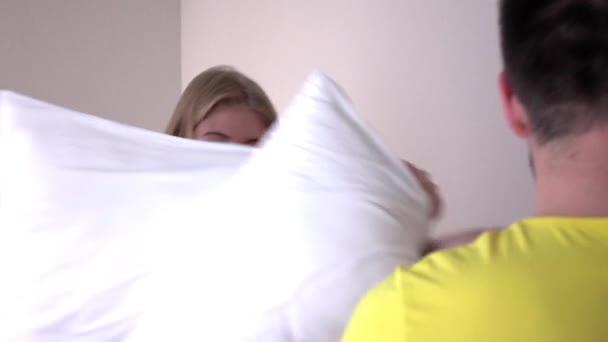 Pillow fight, slowmotion, closeup