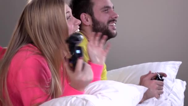 Young couple playing video games at home, slowmotion, closeup